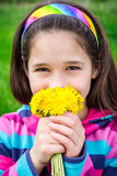 Girl with bouquet of dandelions Stock Photography