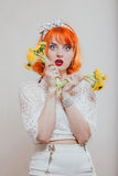 Girl with a bouquet of dandelions Stock Photos