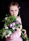 Girl with a bouquet of flowers Stock Photography