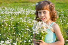 Girl with a bouquet of flowers Royalty Free Stock Photography