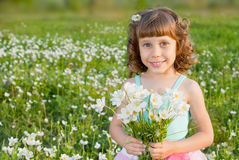 Girl with a bouquet of flowers Royalty Free Stock Photos