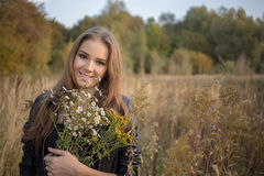Girl with bouquet Stock Photography