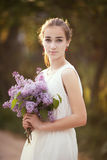 Girl with bouquet of lilac Stock Photo