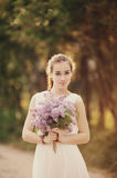 Girl with bouquet of lilac Royalty Free Stock Image