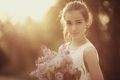 Girl with bouquet of lilac Royalty Free Stock Photo