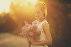 Girl with bouquet of lilac Royalty Free Stock Photos