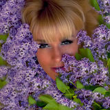 Girl with a bouquet of lilacs Stock Photo