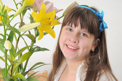 The girl and a bouquet of lilies. Stock Images