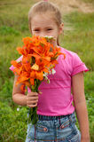 Girl with a bouquet of lilies Stock Photos