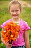 Girl with a bouquet of lilies Royalty Free Stock Image