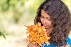 Girl with a bouquet of lilies in  park Royalty Free Stock Photo