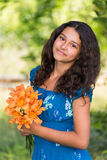 Girl with a bouquet of lilies in  park Royalty Free Stock Images