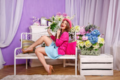 Girl with a bouquet of lilies of the valley laughs Stock Image