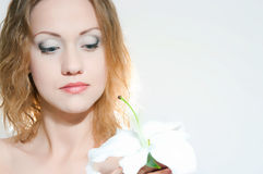 Girl with a bouquet of lilies of the valley Royalty Free Stock Photography