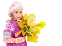 Girl with a bouquet of oak leaves Royalty Free Stock Image