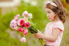Girl with bouquet Stock Photos