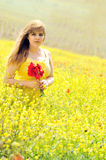 Girl with bouquet of poppies Stock Images