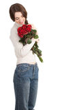 Girl with a bouquet of red roses Royalty Free Stock Photos
