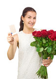Girl with bouquet of red roses and card in hand. Royalty Free Stock Images