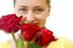 Girl with a bouquet of roses Royalty Free Stock Photography