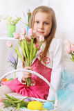 Girl with a bouquet of tulips Royalty Free Stock Image