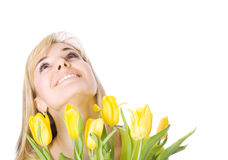 Girl with bouquet of tulips Stock Photos