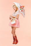 Girl with bouquet and umbrella Royalty Free Stock Images