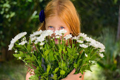 The girl with a bouquet of white flowers Stock Photography