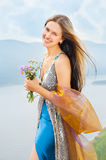 Girl with a bouquet of wild flowers Royalty Free Stock Image