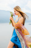 Girl with a bouquet of wild flowers stock images