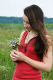 Girl with a bouquet of wildflowers. Pretty young girl with a bouquet of wildflowers  in summer meadow Royalty Free Stock Photography
