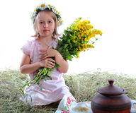 The girl with a bouquet of yellow flowers Royalty Free Stock Images