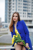 Girl with bouquet of yellow tulips Royalty Free Stock Images