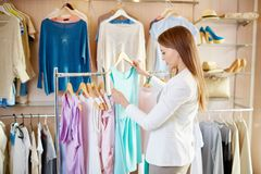 Girl in boutique Royalty Free Stock Photos