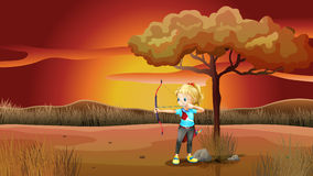 A girl with a bow and arrow Royalty Free Stock Image