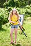 Girl with bow and arrows near sport aim Stock Image