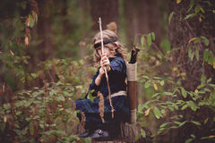 Girl with Bow and Arrows Stock Images
