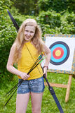 Girl with bow near sport aim Stock Image