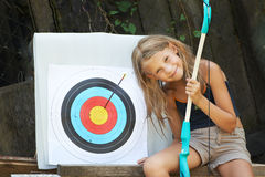 Girl with bow and sports aim. Happy girl with bow and sports aim royalty free stock photos
