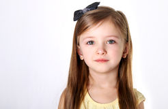 Girl with a bow Stock Images