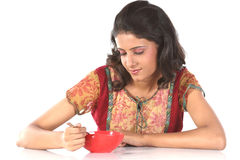Girl with bowl of food Royalty Free Stock Images