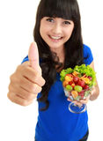 Girl with a bowl of fruit salad Stock Photography