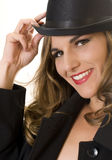 Girl in a Bowler Hat. Blonde Fashion Model in Bowler Hat and Men's Raincoat royalty free stock photos