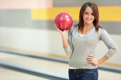 Girl with a bowling ball Royalty Free Stock Photography