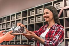 Girl with bowling shoes Royalty Free Stock Photography