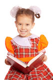 Girl with bows reads  book Royalty Free Stock Photography