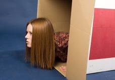 Girl in box Royalty Free Stock Photos