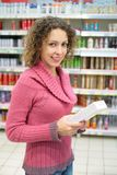 Girl with box in hands in store. Girl with box in hands in modern store Stock Image