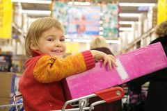 Girl with box in store Royalty Free Stock Image