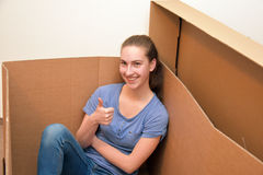 Girl in a box Royalty Free Stock Photography